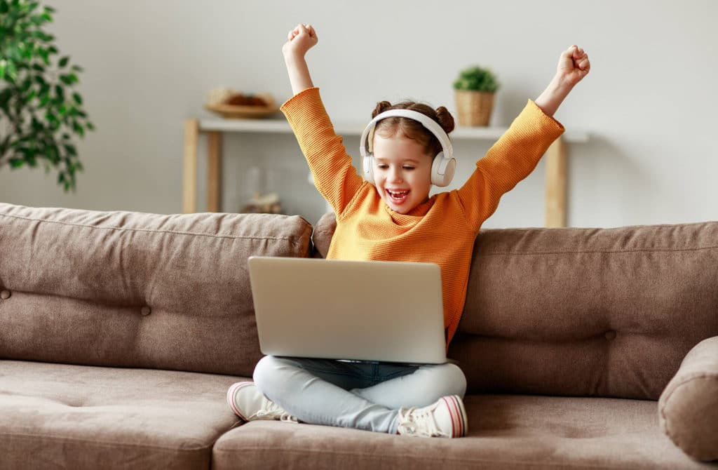 Girl excited about listening to a free audiobook for kids